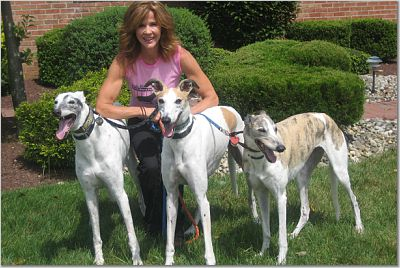 Linda Blair with some greyhound friends